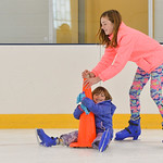 Justin Sheely | The Sheridan Press Four-year-old Isabella Koval holds onto the cone as Kailey Koval pushes her over the ice during the season opening day Saturday at Whitney Rink at the M&Mâ ...