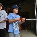 Justin Sheely | The Sheridan Press Nine-year-old Jacob Layher, left, and Tanner Layher, 7, spray a target outside the bay door for the Junior Firefighter Combat Challenge during the Fire Pre ...