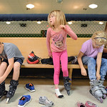 Justin Sheely | The Sheridan Press First-grader Molly Pavey, middle, stands up as she tries on a pair of roller blades during the YMCA's Big Horn Fun Day Friday at Scotty's Skate Castle. ...