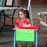 Justin Sheely | The Sheridan Press Five-year-old Sophi Cox waits as she sells her homemade brownies during the last Farmers Market of the season Thursday on Grinnell Plaza.