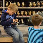 Justin Sheely | The Sheridan Press First-grader Finn Stalick checks his shoes before checking out a pair of skates during the YMCA's Big Horn Fun Day Friday at Scotty's Skate Castle. The ...