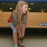 Justin Sheely | The Sheridan Press Second-grader Emma Meyer pulls on a set of skates during the YMCA's Big Horn Fun Day Friday at Scotty's Skate Castle. The YMCA's Fun Friday program p ...