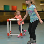 Justin Sheely | The Sheridan Press Fourth-grader Lindsey Walker, front, and Kyle Taylor skate during the YMCA's Big Horn Fun Day Friday at Scotty's Skate Castle. The YMCA's Fun Friday  ...