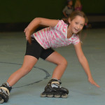 Justin Sheely | The Sheridan Press Second-grader Avery Nikirk falls down in her roller blades during the YMCA's Big Horn Fun Day Friday at Scotty's Skate Castle. The YMCA's Fun Friday  ...