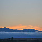 Justin Sheely | The Sheridan Press A patch of fog is seen in front of the Bighorn Mountains Tuesday night from the Sheridan County Airport. This week is to remain cool and rainy until Friday ...