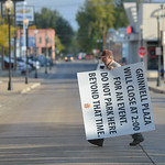 Justin Sheely | The Sheridan Press Volunteer Clark McClung carries a sign across Gould Street at Grinnell Thursday morning in preparation for the Farmers Market later that day. McClung says  ...