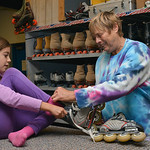 Justin Sheely | The Sheridan Press First-grader Lillian Sutphin sits on the counter as owner Gail Sidletsky helps her with sizing roller blades during the YMCA's Big Horn Fun Day Friday at ...