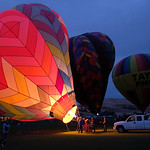 Justin Sheely | The Sheridan Press Hot-air balloon pilots flare their burners to lift the balloons upright during the Balloon the Big Horns night glow Saturday evening at the  Big Horn Eques ...
