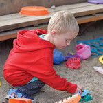 Ashleigh Fox   The Sheridan Press Teigen Schultz, 3, plays with a truck in a sandbox during the Wolf Creek Wrangle at Eaton's Ranch Saturday, Sept. 15, 2018. The Schultz family will work t ...