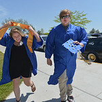 Justin Sheely | The Sheridan Press Graduates Mariah Geertz, left, and Cole Peyrot rush to the school entrance as they run late for assembling prior to the 2016 commencement Sunday afternoon  ...