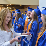 Justin Sheely | The Sheridan Press Faculty members organize the graduates in the hallway prior to the 2016 commencement Sunday afternoon at Sheridan High School.