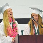 Mike Dunn | The Sheridan Press.  Valedictorian LeeAnna Mitchell, left, and salutatorian Gracie Carr laugh during their joint speech at the Tongue River High School commencement ceremony Sund ...
