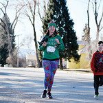 Matthew Gaston   The Sheridan PressLaci Schwend and her son Bronson, 7, on the final leg of the Tongue River Valley Community Center's Ugly Sweater Run Saturday, Dec. 15, 2018.