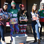 Matthew Gaston   The Sheridan PressFrom left, Beck Bridger, Laci Schwend, Amber Miles, Taylor Greig and Jason Barron pose for a photo with some of the toys donated for the Tongue River Valle ...