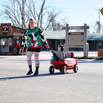 Matthew Gaston   The Sheridan PressDana Peirce nears the finish line of the Tongue River Valley Community Center's Ugly Sweater Run with 4-year-old Hayden Peirce in tow Saturday, Dec. 15,  ...