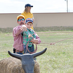 Matthew Gaston | The Sheridan PressLee Whilley instructs Emmitt Garriffa, 3, in the fine art of calf roping during the 2019 BWC Community Easter Carnival & Egg Hunt Saturday, April 20, 2 ...