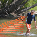 Justin Sheely | The Sheridan Press Twelve-year-old Brant Bockman pulls a makeshift rubber duck catcher from the Tongue River for the duck races during the 40th annual Dayton Days Saturday in ...