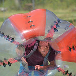 Justin Sheely | The Sheridan Press Brady Lewis picks himself up inside his bubble ball for a game of knocker ball during the 40th annual Dayton Days Saturday in the town of Dayton. The upper ...
