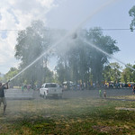Justin Sheely | The Sheridan Press Teams aim their water streams at the suspended barrell to push against the other for the firemen