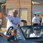 Justin Sheely | The Sheridan Press Parade grand marshall Johann Nield tosses candy from the car for the parade during the 40th annual Dayton Days Saturday in the town of Dayton. The upper-ni ...