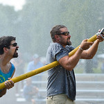 Justin Sheely | The Sheridan Press Zack Cummins, left, and Matt McMeans aim the water jet at the suspended barrell to push against the other team for the firemen