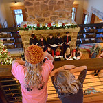 Justin Sheely | The Sheridan Press Children look down from the loft during the 5th annual Ucross Christmas Celebration at the Raymond Plank Creative Center at Ucross Saturday, Dec. 9, 2017.