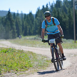 Justin Sheely | The Sheridan Press Andrew Walton turns a corner for the bike race during the Summer Festival Saturday at Antelope Butte ski area. The Antelope Butte Foundation hosted a varie ...