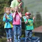 Justin Sheely | The Sheridan Press Cassie Wright and her grandchildren, from left, Ava Wright, Torrum Wright, 5, and Levi Wright, 3, cheer as runners cross the finish line during the Summer  ...