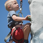 Justin Sheely | The Sheridan Press Five-year-old Liam Wisehart of Greybull climbs up the rock wall during the Summer Festival Saturday at Antelope Butte ski area. The Antelope Butte Foundati ...