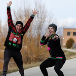 Matthew Gaston | The Sheridan PressRhyan Shultis left and Tannah Sellers right spontaneosly strike a pose in the middle of the CHAPS Ugly Sweater 5K Saturday, Dec. 1, 2018.