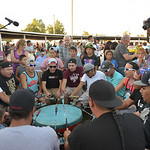 Justin Sheely | The Sheridan Press Spectators watch the drum circle in the arbor during the grand entry powwow Saturday evening during Crow Fair at Crow Agency, Montana. Crow Fair started in ...