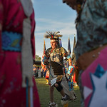Justin Sheely | The Sheridan Press Dancers move to the drum beat during the grand entry powwow Saturday evening during Crow Fair at Crow Agency, Montana. Crow Fair started in 1904 and is cur ...