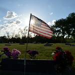 Justin Sheely | The Sheridan Press A flag is set over the grave of a service member during morning decorating on Memorial Day at the Sheridan Municipal Cemetery. Members of the American Legi ...
