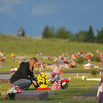 Justin Sheely | The Sheridan Press Mandy Morris replaces a flower bouquet that had fallen during morning decorating on Memorial Day at the Sheridan Municipal Cemetery. Members of the America ...