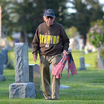 Justin Sheely | The Sheridan Press Korean War Veteran Tom Wallenzien makes sure that no veteran's grave is left without a flag during morning decorating on Memorial Day at the Sheridan Mun ...