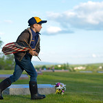 Justin Sheely | The Sheridan Press Eight-year-old Cub Scout Brigham Bailey carries flags to grave sites with empty flag holders during morning decorating on Memorial Day at the Sheridan Muni ...