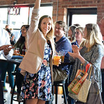 Ashleigh Fox | The Sheridan PressPolly Burge, a 20 Under 40 Class of 2018 honoree, raises her hand in acknowledgement of her honor during The Sheridan Press 20 Under 40 Happy Hour Monday, J ...