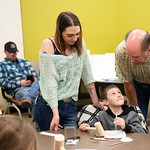 Matthew Gaston | The Sheridan PressBently Mendenhall, 9, gets some advice from Tom Katzke while his mother, Breanna Mendenhall looks on during the Leathercraft Workshop at Sheridan College S ...