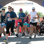 Matthew Gaston | The Sheridan PressParticipants in the Longmire Days 5K race off the starting line in Prosinski Park Friday, July 19, 2019.