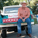 Matthew Gaston | The Sheridan PressAuthor Craig Johnson sits on the back of a 1964 Ford Bronc patiently waiting to reward the participants of the Longmire Days 5K with a cold Rainer beer Fri ...