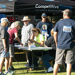 Matthew Gaston | The Sheridan PressFrom left, John Manzella, Michelle Morian and Denise Arnaud register people for the Longmire Days 5k/1 mile walk at Prosinski Park in Buffalo Friday, July  ...