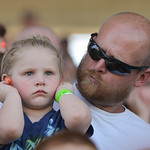 Justin Sheely | The Sheridan Press Three-year-old Avery Jean tries to block the noise from the monster trucks as she sits with Zachary Christensen during the Mega Promotions Monster Truck sh ...