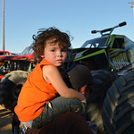 Justin Sheely | The Sheridan Press Two-year-old Dayton Morley rides his father Jeremiah Moreley's shoulders as they wait for an autograph for the VIP pit stop event prior to the Mega Promo ...