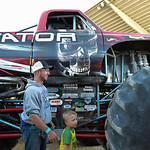 Justin Sheely | The Sheridan Press Ben Mumm and son Dana Mumm, 5, explore the Terminator monster truck for the VIP pit stop event prior to the Mega Promotions Monster Truck show Saturday at  ...