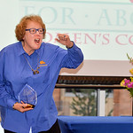 "Justin Sheely | The Sheridan Press Tempe Murphy yells ""Go Broncs"" after accepting the Woman of the Year award during the 2017 FAB Women's Conference Friday at the Sheridan College Whit ..."