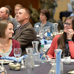 Justin Sheely | The Sheridan Press Carrie Haderlie, left, looks at Carrie Sisson as a video interview of Sisson's nomination by Haderlie is shown on the big screen at the dinner event duri ...