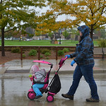 Justin Sheely | The Sheridan Press A woman pushes her daughter under pouring rain during the Out of the Darkness suicide prevention walk Saturday in Sheridan. The event is held annually in S ...