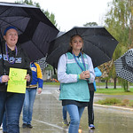 Justin Sheely | The Sheridan Press Abigail James, left, and Karlee Larson walk in support under pouring rain during the Out of the Darkness suicide prevention walk Saturday in Sheridan. The  ...