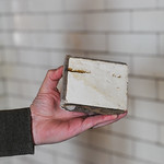 Ashleigh Fox | The Sheridan PressDan Stalker holds a part of the glazed brick taken from the original wall in the railroad station Thursday, March 15, 2018. The Tiffany brick originated fro ...