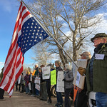 Justin Sheely | The Sheridan Press Vietnam veteran Bruce Andrews holds the national flag upside-down along with dozens of protesters outside the Big Horn Smokehouse & Saloon during Sen. John ...